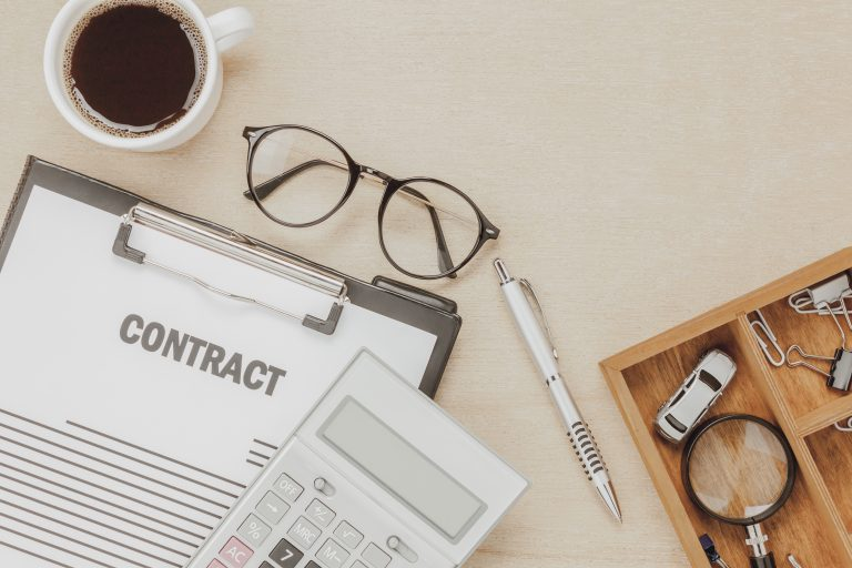 Top view business contract form with coffee eyeglasses car calcu